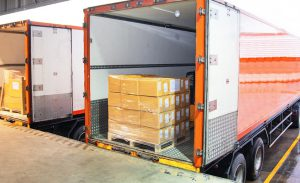 Logistics Consulting Cargo Being Loaded On Truck From Warehouse